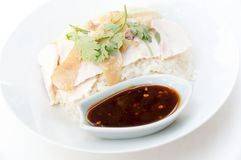 Hainanese chicken rice. Is a dish adapted from early Chinese immigrants originally from Hainan province in southern China. It is considered one of the national Royalty Free Stock Image
