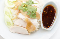 Hainanese chicken rice. Is a dish adapted from early Chinese immigrants originally from Hainan province in southern China. It is considered one of the national Royalty Free Stock Photo