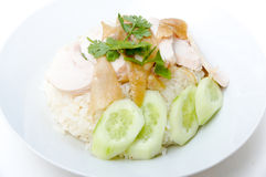 Hainanese chicken rice. Is a dish adapted from early Chinese immigrants originally from Hainan province in southern China. It is considered one of the national Stock Photography