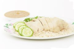 Hainanese chicken rice on plate. Hainanese chicken rice is a popular dish of Asian,which is distributed by Chinese Hainanese Royalty Free Stock Photos