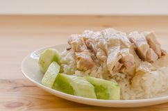 Hainanese chicken rice or rice cooked in chicken broth.  Stock Photo
