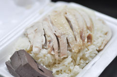 Hainanese chicken rice , rice topped with chicken in a box. Rice topped with chicken in a box Stock Photo