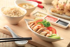 Hainanese chicken rice with sauce. Image of Hainanese chicken rice with sauce Stock Image