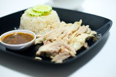 Hainanese chicken rice or steam chicken rice with sauce. On white background Stock Images
