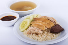 Hainanese chicken rice, steamed chicken, chicken blood and white rice on brown cloth background. Thai food, Hainanese chicken rice, steamed chicken, chicken Royalty Free Stock Image