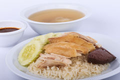 Hainanese chicken rice, steamed chicken, chicken blood and white rice on brown cloth background. Royalty Free Stock Photo
