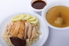 Hainanese chicken rice, steamed chicken, chicken blood and white rice on brown cloth background. Stock Photos