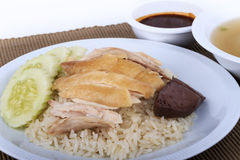 Hainanese chicken rice, steamed chicken, chicken blood and white rice on brown cloth background. Thai food, Hainanese chicken rice, steamed chicken, chicken Royalty Free Stock Photography