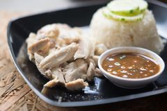 Hainanese chicken rice or steamed chicken in flavored rice Royalty Free Stock Photo