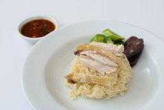 Hainanese chicken rice. Is rice steamed with chicken soup and put bolied chicken on top serv with sauce mix chili,galic,bean paste,lime.sugar,soy sauce Stock Photography