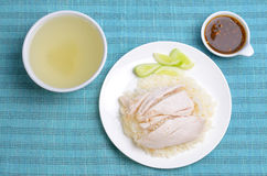 Hainanese chicken rice. (steamed rice with chicken) in white dish with soup and sauce Royalty Free Stock Photography