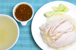 Hainanese chicken rice. (steamed rice with chicken) in white dish with soup and sauce Stock Photography
