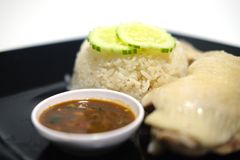 Hainanese chicken rice Thai gourmet steamed chicken with rice. In black dish Stock Photo