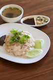 Hainanese Chicken Rice on wood table. Hainanese Chicken Rice on wooden table Royalty Free Stock Image