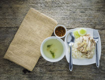 Hainanese chicken rice. On wood,top view Royalty Free Stock Photos