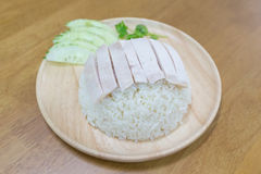 Hainanese chicken rice. On wooden plate Stock Image