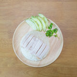 Hainanese chicken rice. On wooden plate Royalty Free Stock Images