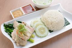 Hainanese Chicken Rice. On wooden table Stock Photo