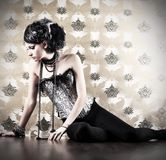 Hair. Beautiful fashionable woman over vintage background Royalty Free Stock Photos