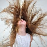 Hair. Beautiful happy smiling girl with long hair Royalty Free Stock Photo