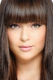 Hair. Closeup portrait of beautiful woman with straight long hair Stock Images
