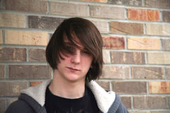 Hair. Cute teen boy with great hair by brick wall Royalty Free Stock Images