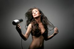 Hair 50. A beautiful woman with hair-dryer Stock Photo