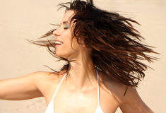 Hair. Woman drying wet hair in the sun while moving royalty free stock images