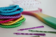Multi colored hair accessories for girls with hairbrush, and bobby pins Royalty Free Stock Photo