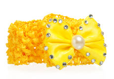 Hair accessories. Yellow new bright hairgrip isolated on white background close-up Stock Photo