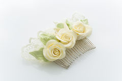 Hair accessory. BEautiful hair slide decorated with flowers and lace. Isolated over white background stock photography