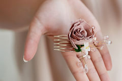 Hair accessory handmade. Close.Located on the open palm. Delicate pastel shades Stock Photo