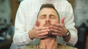 Hair beard and mustache treatment in barber shop stock footage