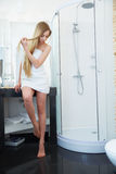 Hair. Beautiful Blond Brushing Her Hair. Hair Care. Spa Beauty M Royalty Free Stock Images