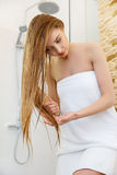 Hair. Beautiful Blond Brushing Her Wet Hair. Hair Care. Spa Beau Royalty Free Stock Photography