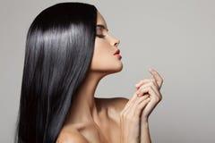Hair. Beautiful Brunette Girl. Healthy Long Hair. Stock Photo