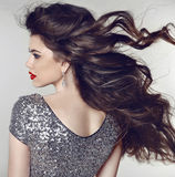 Hair. Beautiful model girl with healthy long wavy shiny hair iso Royalty Free Stock Photos