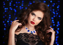 Hair. Beautiful Brunette Woman. Red lips makeup. Fashion ge Royalty Free Stock Photography