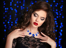 Hair. Beautiful Brunette Woman. Red lips makeup. Fashion ge Stock Images