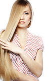 Hair beauty. Portrait of young beautiful woman with long glossy blond hair Royalty Free Stock Photography