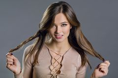 Hair. Beauty fashion model woman touching her long and healthy brown hair. stock photography