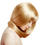 Hair. Beauty young woman with luxurious long blond hair. Girl wi Royalty Free Stock Images