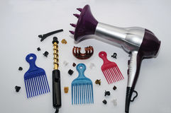 Hair Blow Dryer And Curling Iron , Combs and Hair Clip. S On A White Background Royalty Free Stock Image