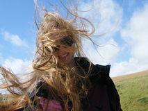 Hair blowing in the wind. Closeup of a woman with hair blowing in wind stock photography