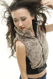 Hair blowing in the wind. A beautiful Asian woman with her hair blown back Stock Photography