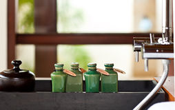 Hair and body care products in bathroom Royalty Free Stock Photos