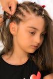 Hair braids. Hairdresser make braids in beauty salon Stock Image