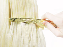Hair brush with blond hair in it Royalty Free Stock Image