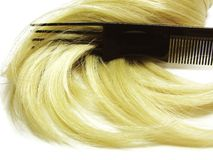 Hair brush with blond hair in it Stock Photos