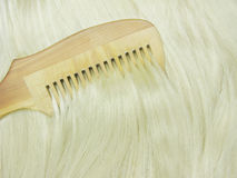 Hair brush brushing blond hair Royalty Free Stock Photography
